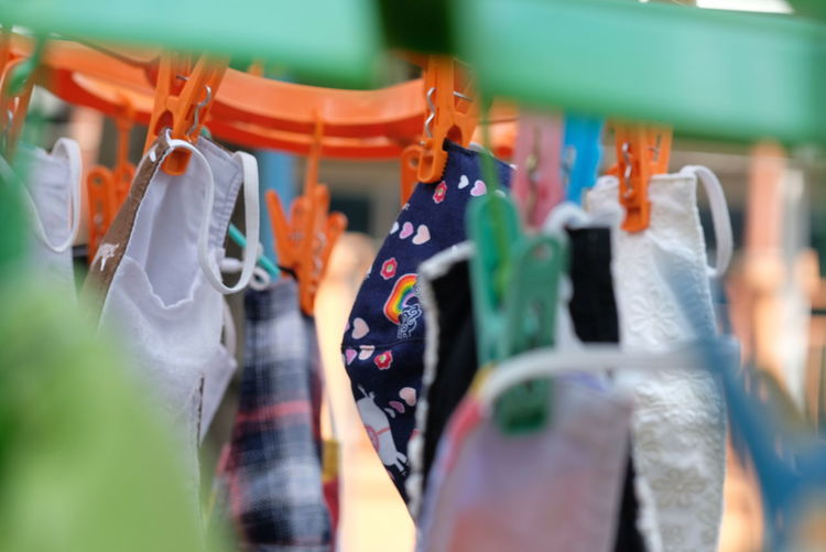 Close-up of multi colored clothespins hanging at market stall