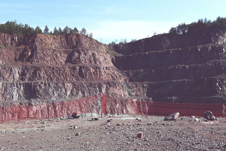 open pit mine with red safety net. mining industry. porphyry rock. Surface Mine Rock Porphyry Rock Formation Surface Mining QuarryRock Quarry Rock Safety Net Open Pit Mining Open Pit Mine Mine Mining Quarry Mining Pit Mining Heritage Mining Industry Safety First!