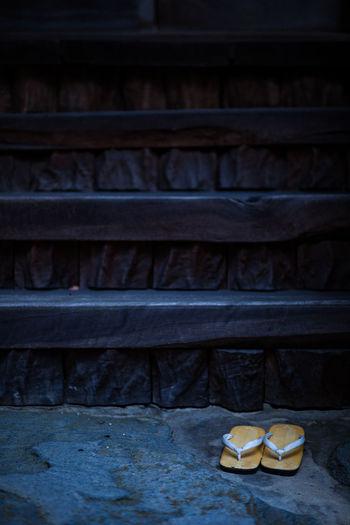 Close-up of flip-flops on steps