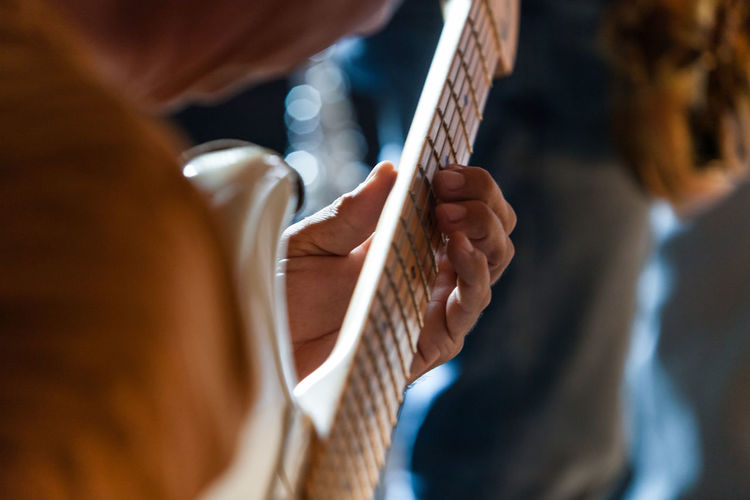 Close-up of hand holding guitar