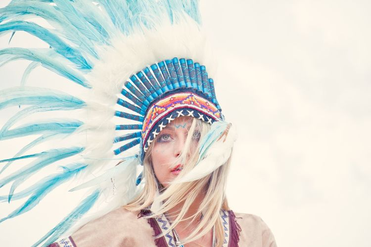 Young woman looking away while wearing headdress