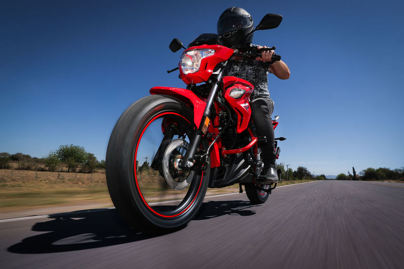 Transportation Motorcycle Mode Of Transportation Riding Ride Sky Road Motion One Person Nature Land Vehicle Clear Sky Sport Day Helmet Sunlight Extreme Sports Headwear Speed Leisure Activity Biker Outdoors Crash Helmet Road Trip