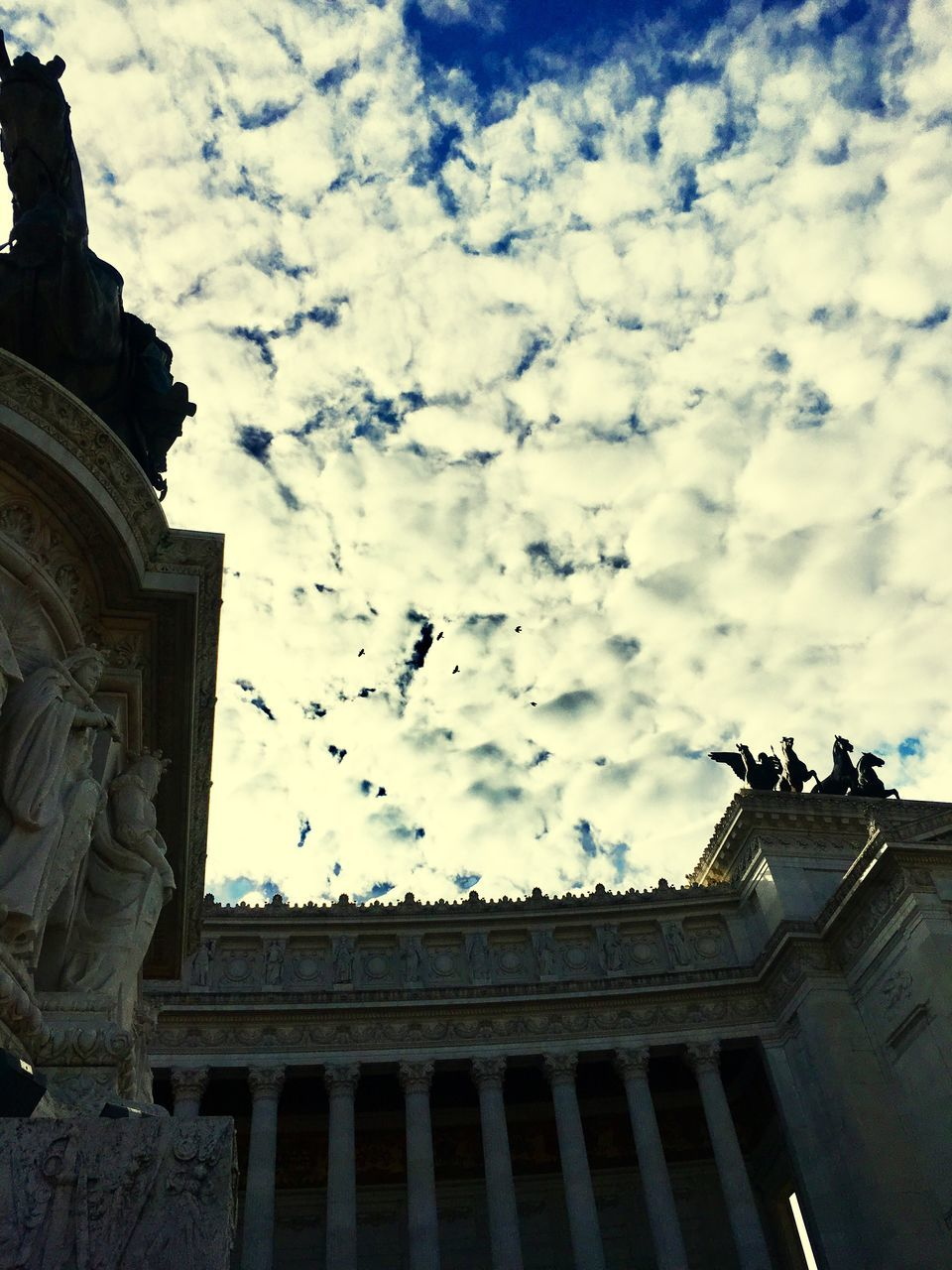 statue, sculpture, cloud - sky, sky, architecture, art and craft, low angle view, built structure, human representation, building exterior, history, creativity, outdoors, travel destinations, day, architectural column, no people, city
