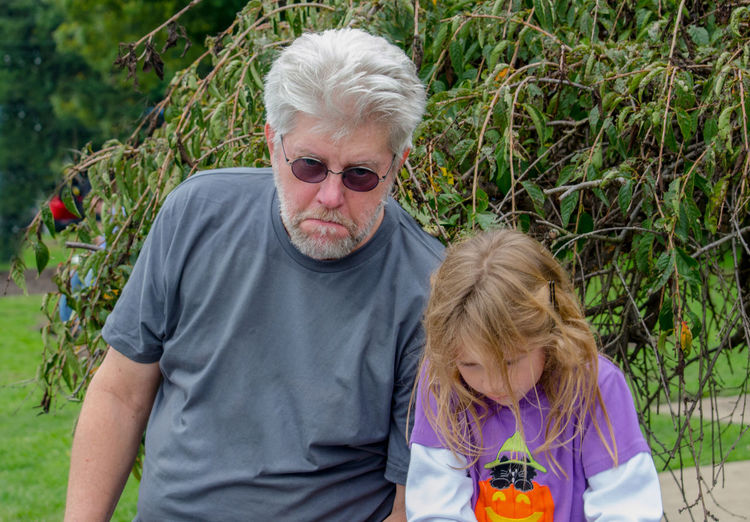Grandpa and granddaughter are sad their fun day has to end and it's time to go home