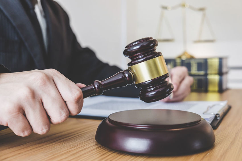 Lawyer Adult Advocate Balance Barrister Body Part Consultant Counselor Fairness Gavel Hand Holding Human Hand Indoors  Inheritance Judge Judgement Legal Legislation Men Notary Occupation One Person Verdict Wood - Material