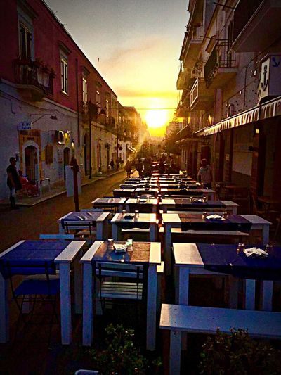 Sunset Building Exterior Architecture Built Structure Chair Sunlight Outdoors Street City Sky Day No People Streetphotography waiting for the dinner