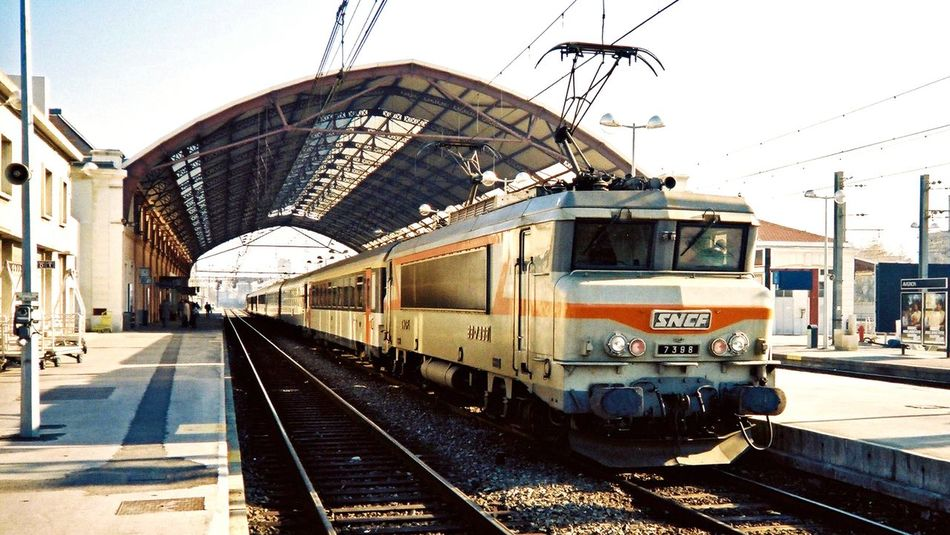 Your Ticket To Europe Railroad Track Transportation Mode Of Transport Rail Transportation Public Transportation Train - Vehicle Day Sky Outdoors Cable Built Structure Railroad Station Building Exterior Railroad Station Platform Clear Sky Electricity Pylon Architecture No People City Sncf France France 🇫🇷