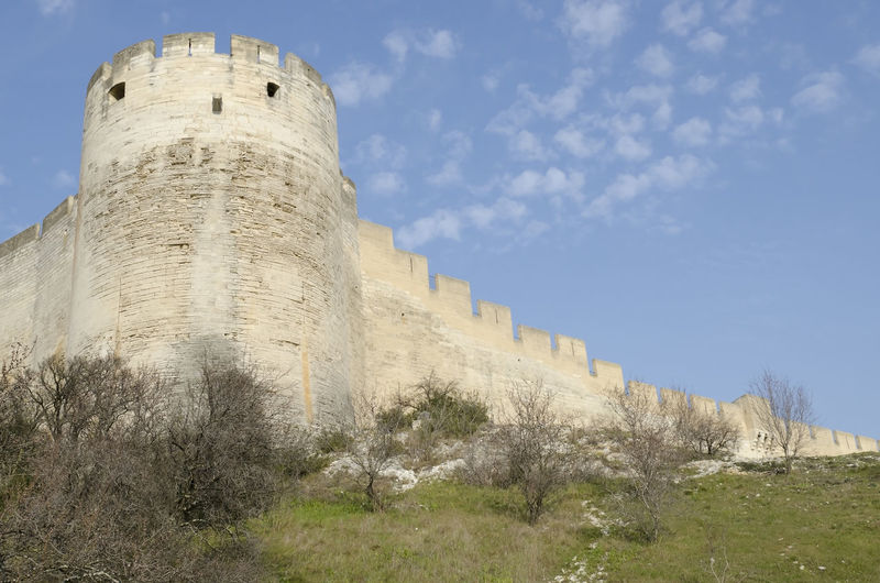medieval fortress, stone sentinel in France Ancient Ancient Civilization Architecture Building Building Exterior Built Structure Castle Day Fort Fortified Wall Fortress History Low Angle View No People Old Outdoors Sky Stone Wall The Past Tower Villeneuve-lez-avignon Wall