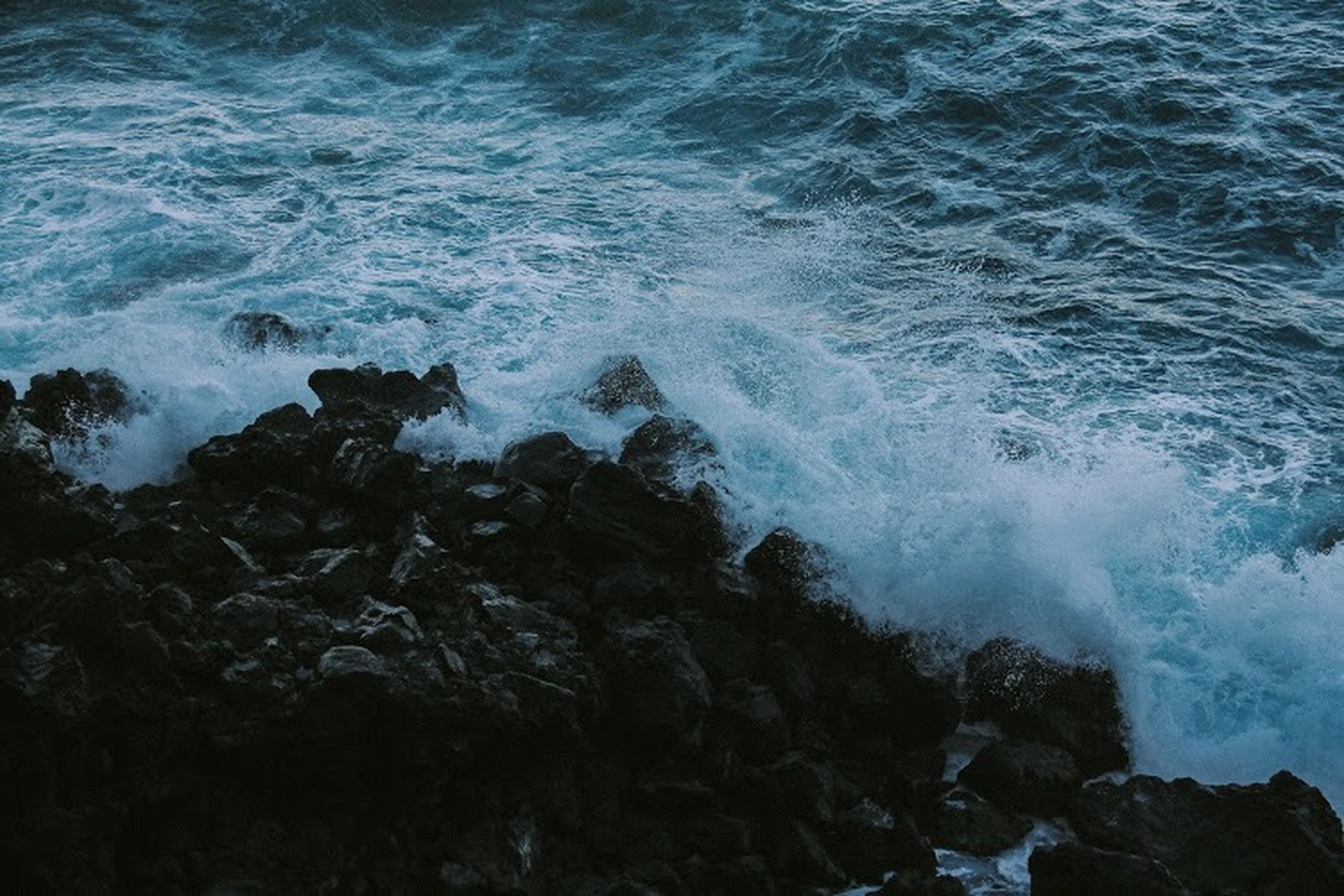 sea, rock, water, motion, rock - object, wave, solid, beauty in nature, no people, rock formation, sport, beach, nature, splashing, land, power in nature, power, scenics - nature, outdoors, breaking, hitting, flowing water, rocky coastline