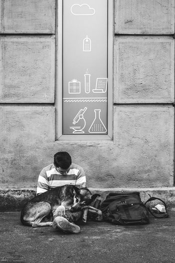 Black And White Blackandwhite Dog Dogs On The Street Homeless Homeless Man Homeless Man And His Dog Homeless Person Homelessness  Loyal Dog Loyalty Man Man And Dog Man And His Best Friend Sign Street Dogs Symbol Wall Wall - Building Feature Up Close Street Photography Telling Stories Differently