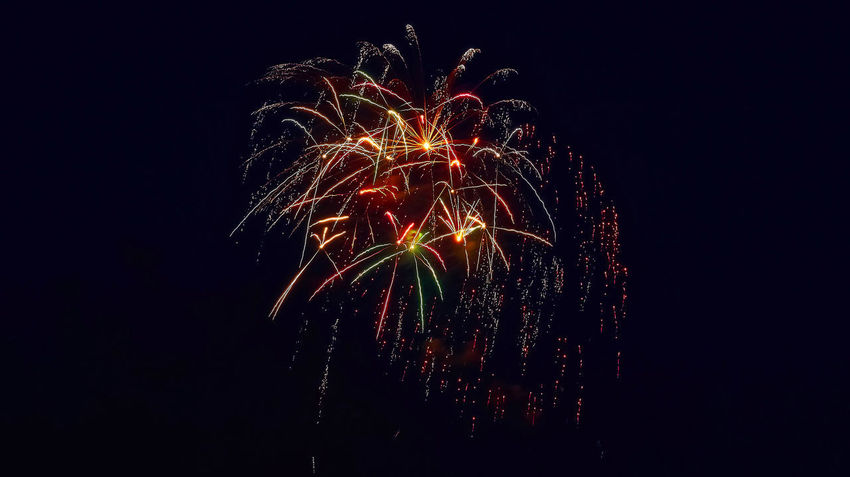 Arts Culture And Entertainment Black Background Celebration Copy Space Event Exploding Firework Firework - Man Made Object Firework Display Glowing Illuminated Light Long Exposure Low Angle View Motion Multi Colored Nature Night No People Sky Sparks