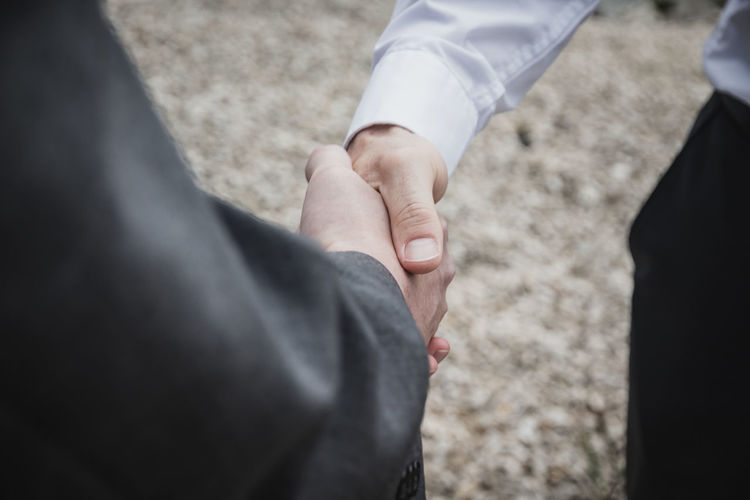 Cropped image of businessman doing handshake