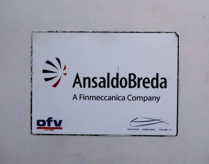 Rome, Italy - August 16, 2017: AnsaldoBreda sign. AnsaldoBreda S.p.A., a subsidiary of Finmeccanica, designs and manufactures locomotives and mass transit systems for operators of public transport Logo Ansaldobreda Close-up Communication Editorial  Engineering Finmeccanica No People Rail Transport Rail Transportation Text Western Script