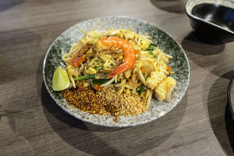 High angle view of pad thai served in plate on table