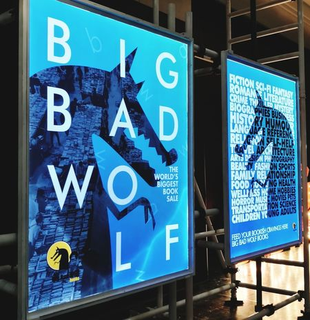 24hours daily sale of Big Bad Wolf book is back in our town. We're in and couldn't find our way out..😀📚😍 Be. Ready. Advertising Signage Booksale BigBadWolf EyeEmNewHere Ads Text Communication Blue Business Finance And Industry No People Day Outdoors Built Structure