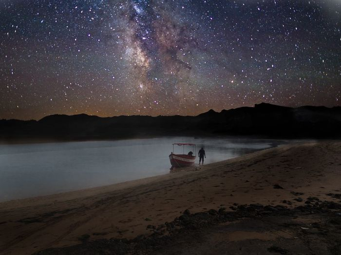 Milky Way Sky Night Water Star - Space Beauty In Nature Transportation Land Tranquil Scene Star Space Star Field Nature Mode Of Transportation Astronomy Galaxy Lake Outdoors Beach Scenics - Nature Tranquility