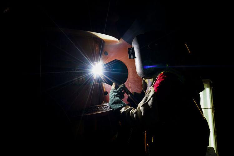 Man working on illuminated stage