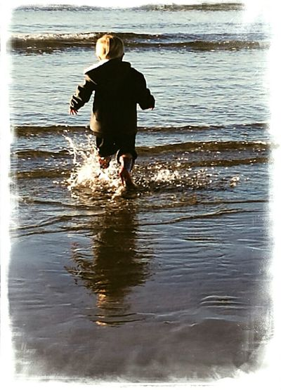 One Person Beach Day Outdoors water child sea splashing waves childhood nostalgic