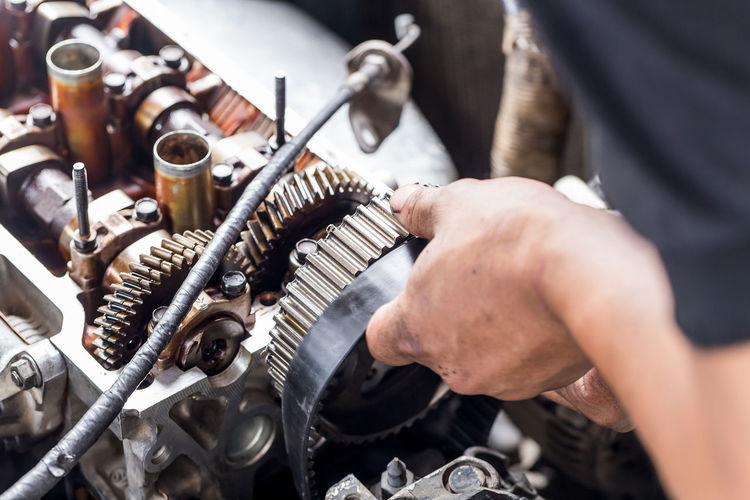Man Repairing Machinery
