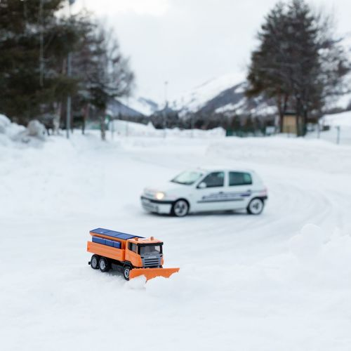 Close-up of car on snow covered road