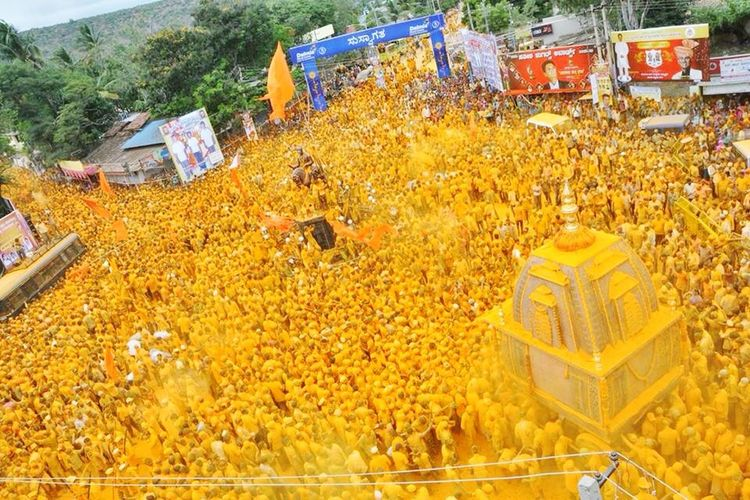 Collected Community Lakhs of devotees of Godess Laxmi working together to pull chariot in towns fare. Full of turmeric powder