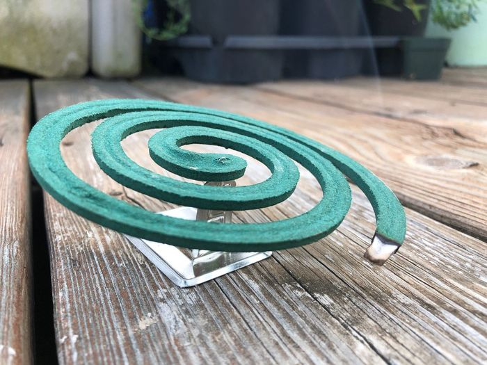 Close-up of burning mosquito coil on table