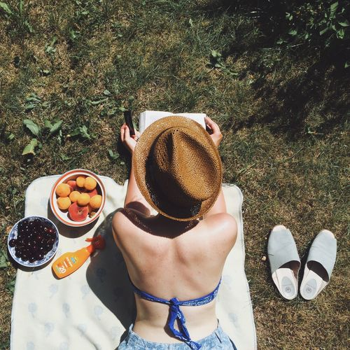 EyeEm Selects EyeEm Selects High Angle View Day Grass One Person Outdoors Real People Food And Drink Leisure Activity Refreshment Fruit Shadow Directly Above Lifestyles Freshness Drink Women Low Section Nature People EyeEm Selects