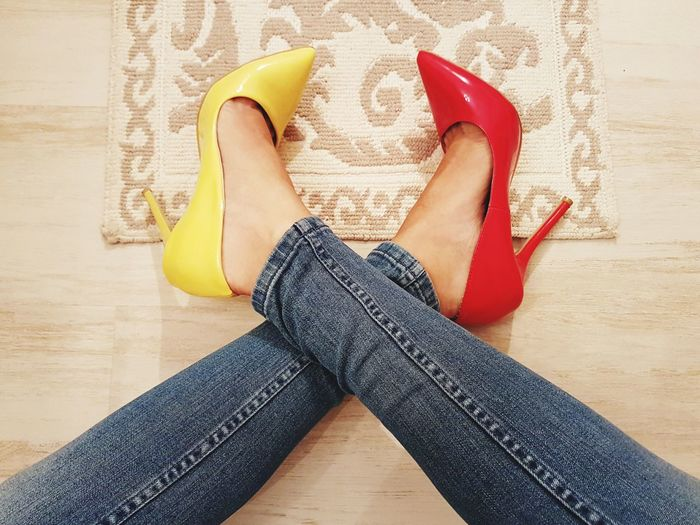 Hardwood Floor Indoors  Human Leg Human Body Part Low Section Fashion&love&beauty Fashion 100 Shades Of Yellow Woman Feet Feet Shoes Bluejeans Jeans High Heels Stilletos Yellow Stilletos Red Stilletos Red Color Yellow Color Paint The Town Yellow Red And Yellow Vibrant Colors