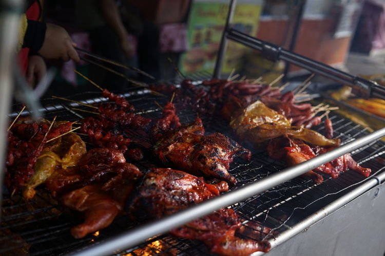 Ramadan bazaars Meat Barbecue Cooked Grilled Barbecue Grill Preparation  Close-up Food And Drink Street Food