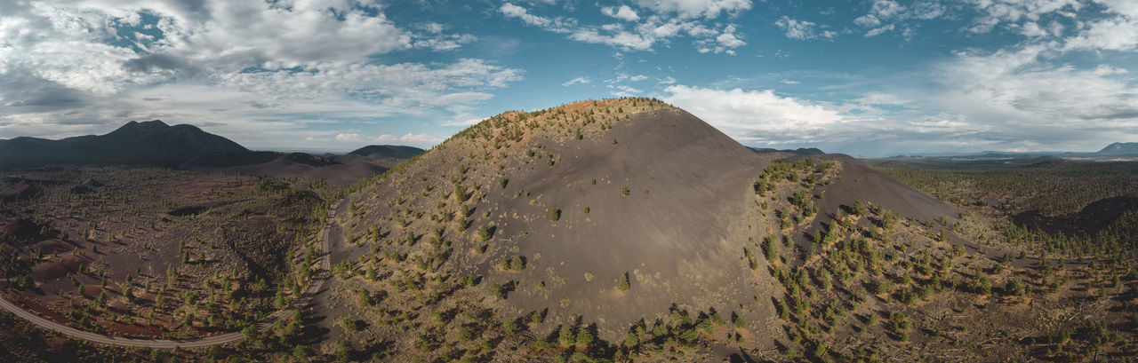 Panorama drone shot of the Sunset Crater volcanic landscape near Flagstaff, Arizona, USA. Sunset Crater Volcano National Monument Sunset Crater Volcano Volcanic Landscape Volcanic Crater Cinder Cone Flagstaff Arizona Crater San Francisco Volcanic Field Erupted Panorama Drone  Drone Photography DJI X Eyeem Landscape Eroded Eroded Landscape Formation Sky Mountain Cloud - Sky Scenics - Nature Travel Destinations Deserted