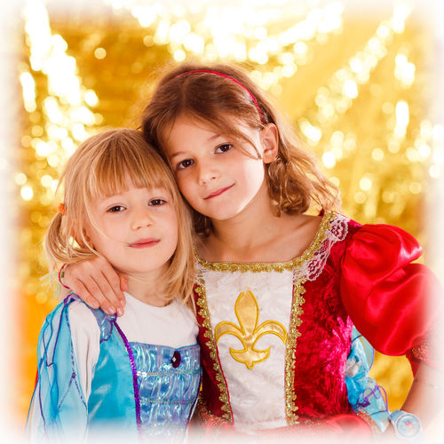 Two young girls disguised as princess 2 Girls Community Gold Princess Siblings Background Blond Hair Bokeh Carneval Carnevale Child Childhood Close-up Females Friendship Girls In Disguise Indoors  Kostüm Looking At Camera People Portrait Smiling Togetherness Two People