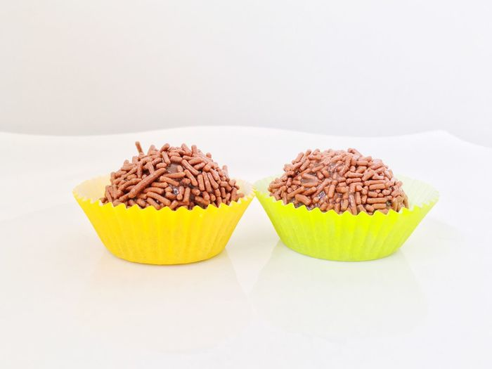 Brigadeiro Brazilian Sweet Brigadeiro Food And Drink White Background Studio Shot Indoors  Freshness Food Still Life Sweet Food Copy Space Temptation No People Indulgence Sweet Dessert Side By Side Unhealthy Eating Group Of Objects Close-up Cake Cupcake
