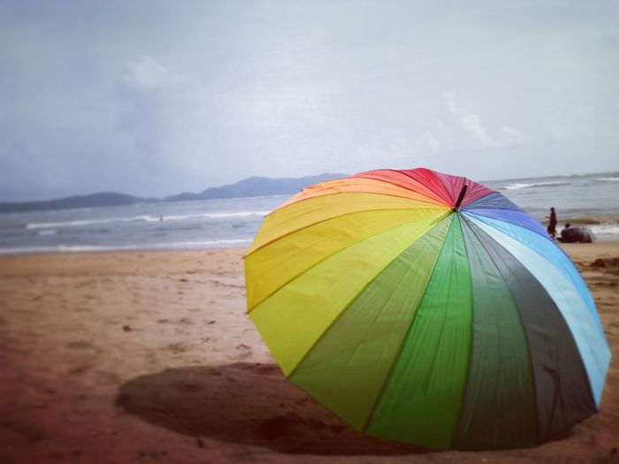 Beach Sand Sea Water Summer Protection Vacations Nature Cloud - Sky Multi Colored Day Tranquility Outdoors No People Landscape Horizon Over Water Sky Beauty In Nature Nature Flying Over Your Imagination Umbrella☂☂ Umbrellarevolution UmbrellaGirl Umbrellatime Rainbow Colours