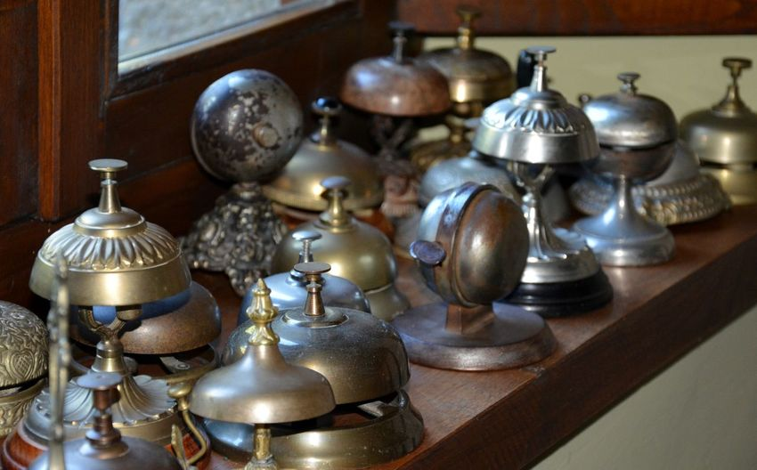 High Angle View Of Various Bells On Table