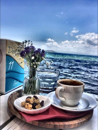 Flower Table Plate Vase Saucer Food And Drink No People Drink Freshness Coffee - Drink Breakfast Day Place Setting Sky Nature Horizon Over Water Water Napkin Food Sea
