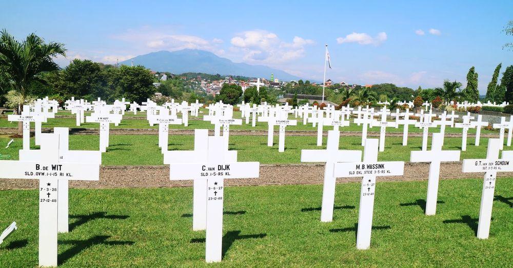 Row of cemetery against sky