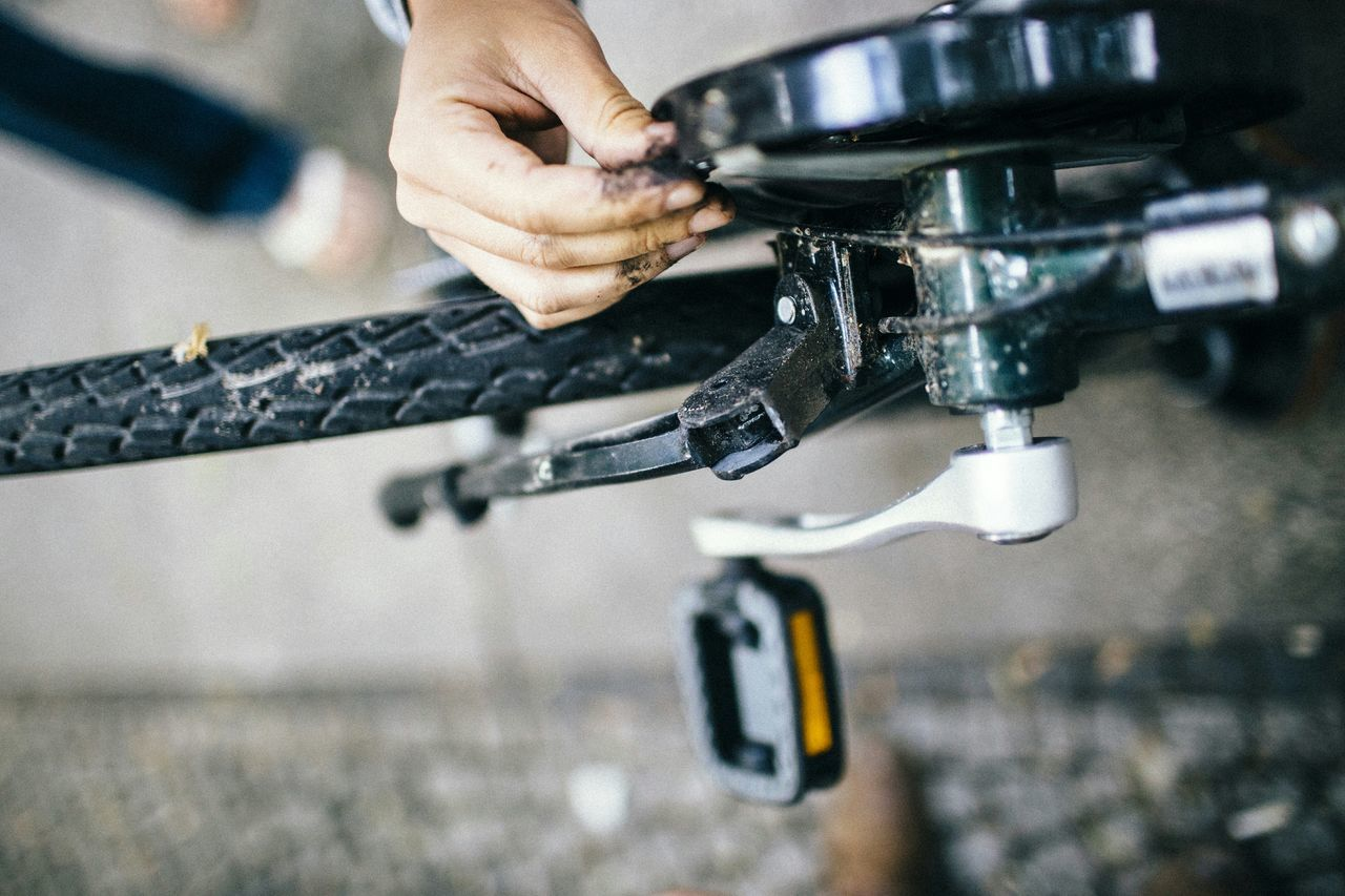 High angle view of person repairing bicycle