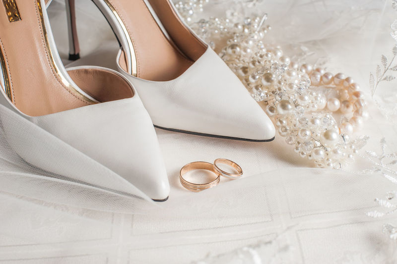 High heels with rings on table