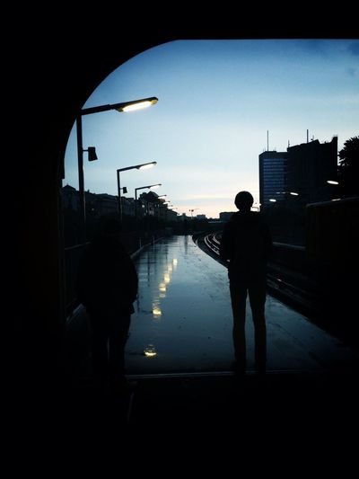 Silhouette of woman standing by railing