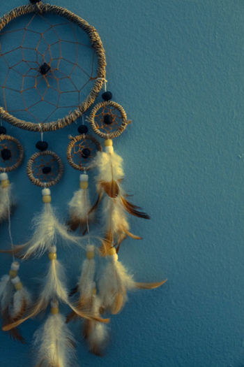 Dreamcatcher Against Blue Wall