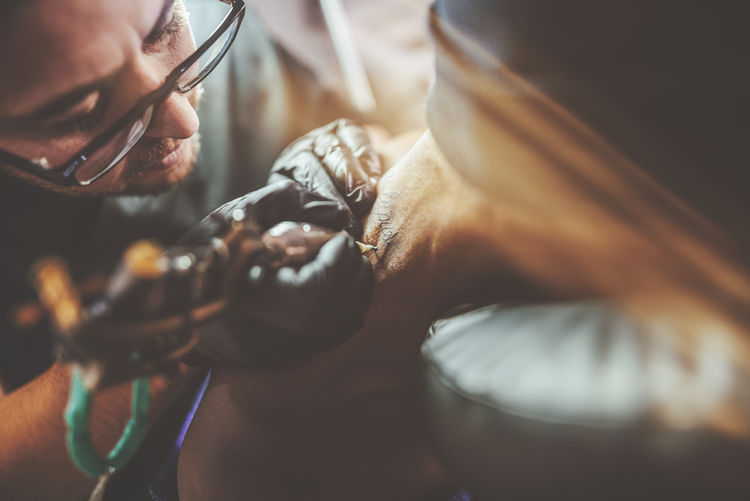Tattooist making a tattoo on the nape Tattoo Artist Tattooed Work Working Close-up Human Hand Indoors  Occupation Ocupation One Person People Real People Selective Focus Tatoo Art Tattoo tattoo life Tattooing Tattooist Working Workshop Young Adult