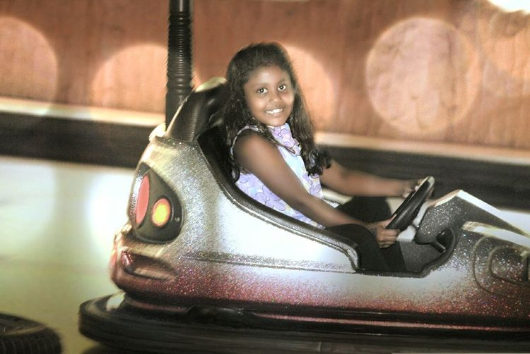 Bedazzled Portrait One Person Looking At Camera Sitting One Woman Only Only Women Full Length Adults Only Beautiful People Beauty One Young Woman Only People Beautiful Woman Indoors  Smiling Adult Day Young Adult Dashing Car Amusement Park Sport Outdoors