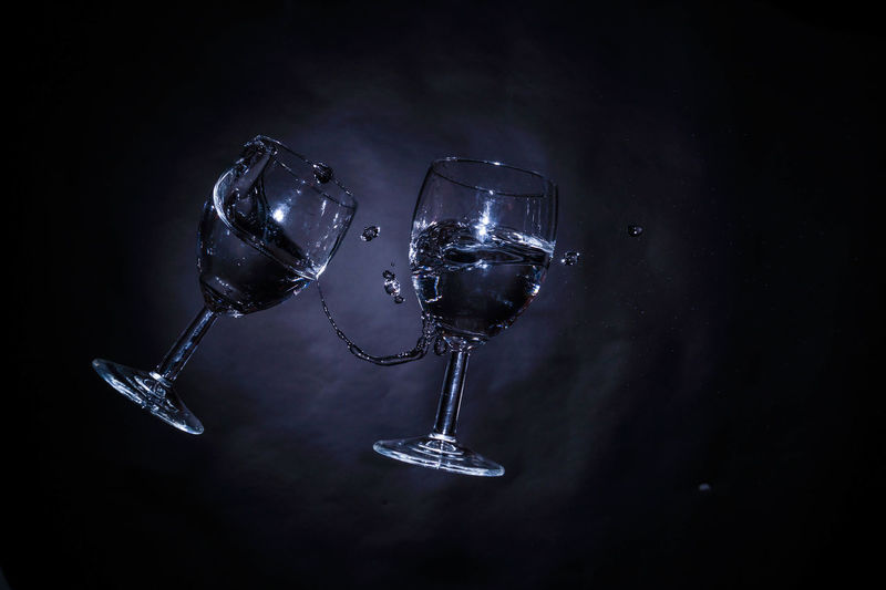 Wineglasses Black Background Close-up Crystal Dark Decor Decoration Electric Lamp Focus On Foreground Glowing Illuminated Lighting Equipment No People Still Life