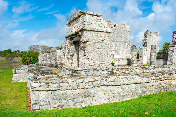 Tulum Mexico Ruins Unesco Zona Arqueológica History Architecture The Past Built Structure Sky Cloud - Sky Ancient Old Ruin Grass Nature Plant Day Ancient Civilization Old Solid Building Exterior No People Travel Wall Travel Destinations Stone Material Archaeology Stone Wall Outdoors Deterioration