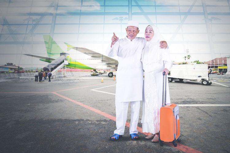 People standing on airport runway