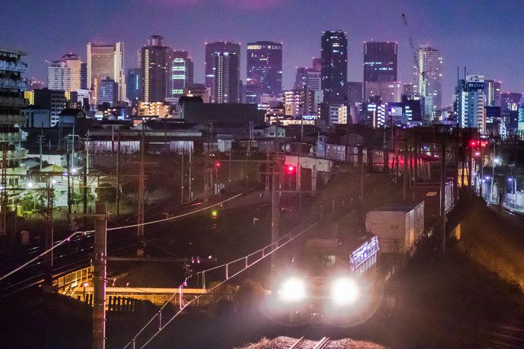 真夜中のニーナ(貨物機関車EF66-27) Nightphotography Cargo Locomotive OSAKA Japan City Cityscape Urban Skyline Illuminated Skyscraper Modern City Life High Angle View Architecture Sky Light Trail Headlight Traffic