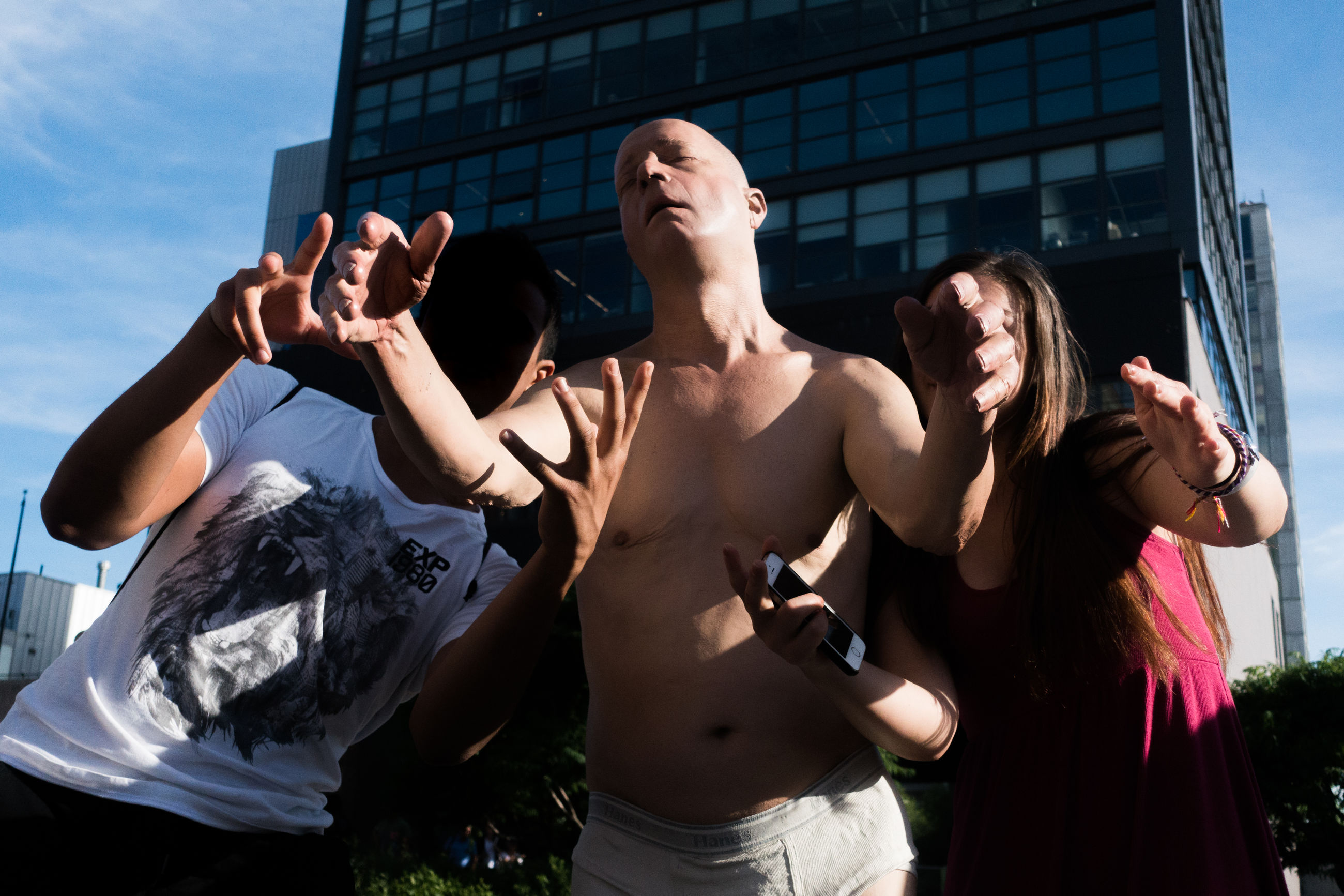 shirtless, arms raised, outdoors, real people, standing, building exterior, day, young women, young adult, togetherness, men, women, architecture, human hand, sky, people