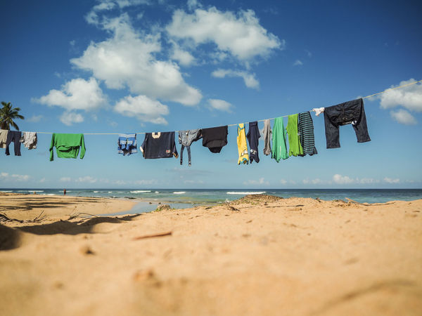 LINE Washing Beach Beauty In Nature Clothes Clothline Dry Drying Hanging Horizon Over Water Nature No People Sand Scenics Sea Sky Water