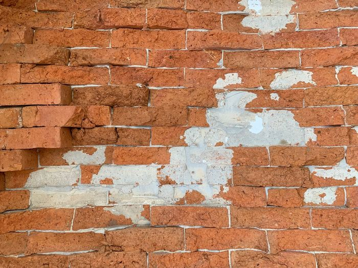 Wall - Building Feature Brick Brick Wall Built Structure Full Frame Wall Architecture Textured  Backgrounds No People Day Weathered Damaged Close-up Building Exterior Old Outdoors Pattern Rough Bad Condition Cement Concrete