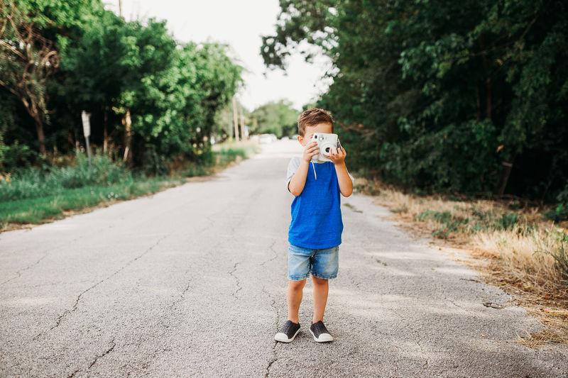 Full length portrait of boy on road